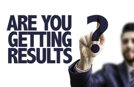 Business man pointing to transparent board with text: Are you getting results?