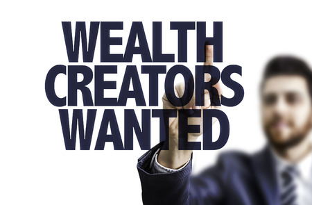innovator: Business man pointing to transparent board with text: Wealth creators wanted