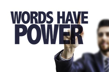 Business man pointing to transparent board with text: Words have power Lizenzfreie Bilder