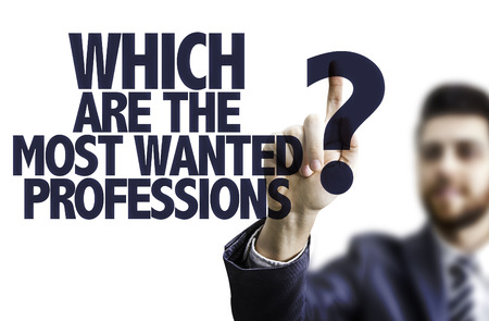 most talent: Business man pointing to transparent board with text: Which are the most wanted professions? Stock Photo