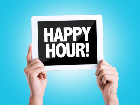 hands  hour: Hands holding tablet pc on blue background with text: Happy hour!
