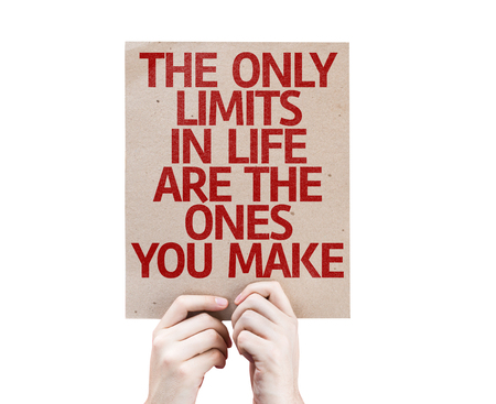 cardboard only: Hands holding cardboard on white background with text: The only limits in life are the ones you make
