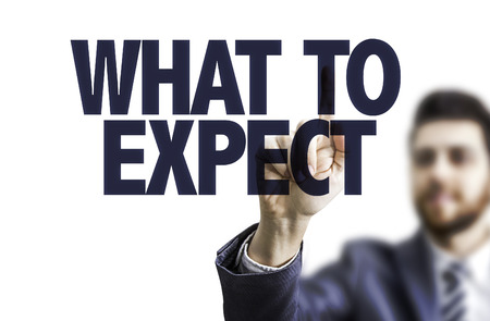 Business man pointing to transparent board with text: What to expect
