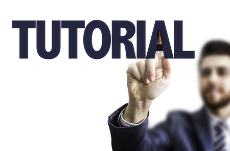 tutorial: Business man pointing to transparent board with text: Tutorial Stock Photo