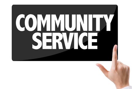 community service: Business man pressing button with text: Community service