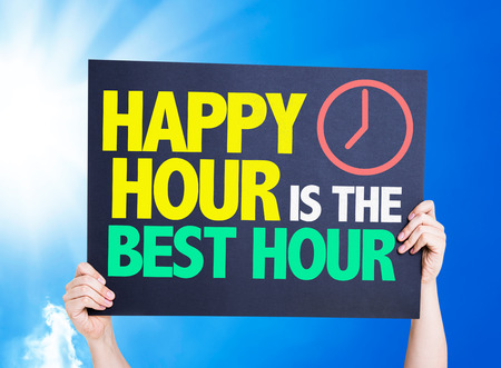 Hands holding cardboard on sky background with text: Happy hour is the best hour
