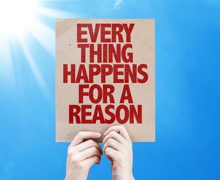 happens: Hands holding cardboard on sky background with text: Everything happens for a reason