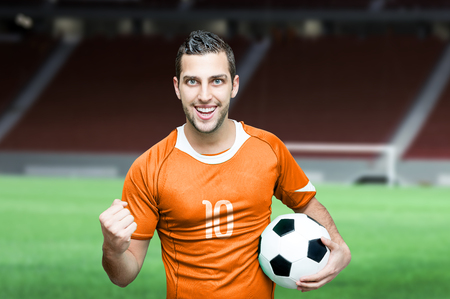 Dutch fan celebrates on stadium background