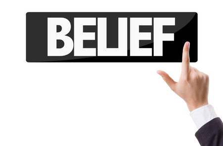 belief: Business man pressing button with text: Belief