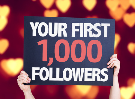 followers: Hands holding cardboard on heart bokeh background with text: Your first 1000 followers