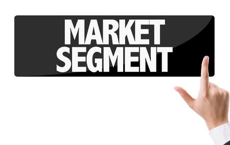 segmentar: Business man pressing button with text: Market segment Foto de archivo