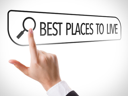 url virtual: Hand searching online on white background with text: Best places to live Stock Photo