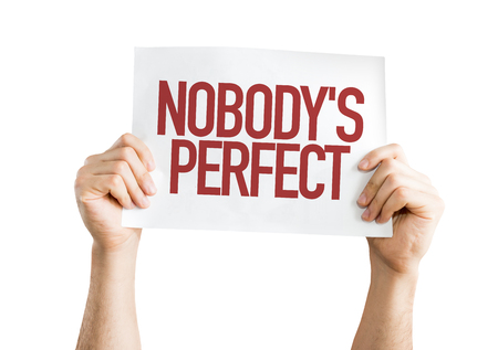 perfectionist: Hands holding cardboard on white background with text: Nobodys perfect