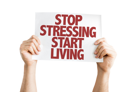 stressing: Hands holding cardboard on white background with text: Stop stressing start living