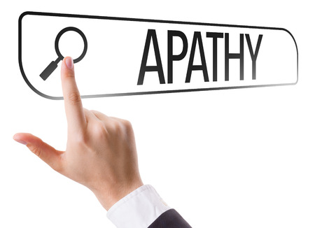 apathy: Hand searching online on white background with text: Apathy Stock Photo