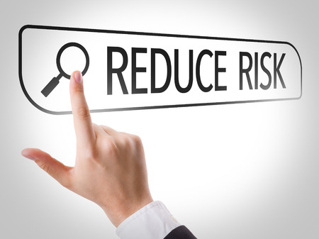 reduce risk: Hand searching online on white background with text: Reduce risk Stock Photo