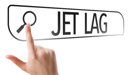 lag: Hand searching online on white background with text: Jet lag Stock Photo