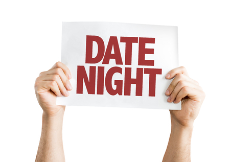 date night: Hands holding cardboard on white background with text: Date night Stock Photo