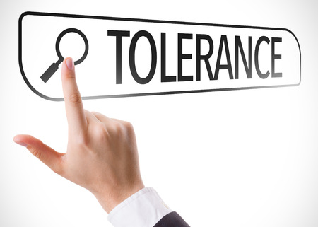 tolerancia: Hand searching online on white background with text: Tolerance