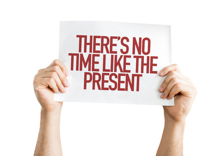 no time: Hands holding cardboard on white background with text: Theres no time like the present