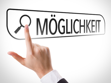 plausible: Hand searching online on white background with text: Moglichkeit (possibility in German) Stock Photo