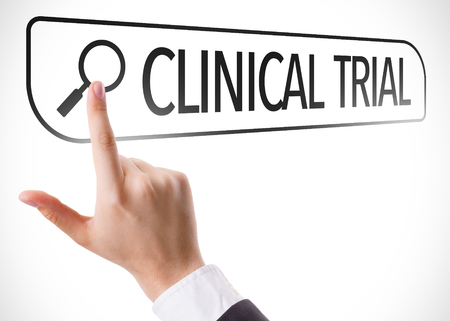 Hand searching online on white background with text: Clinical trial
