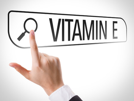 url virtual: Hand searching online on white background with text: Vitamin E