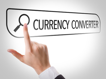 converter: Hand searching online on white background with text: Currency converter