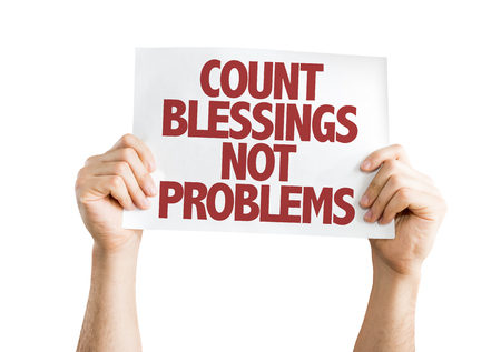 blessings: Hands holding cardboard on white background with text: Count blessings not problems Stock Photo