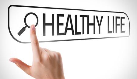 url virtual: Hand searching online on white background with text: Healthy life Stock Photo