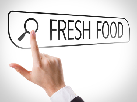 url virtual: Hand searching online on white background with text: Fresh food Stock Photo