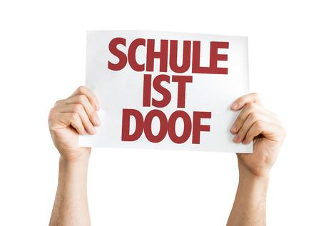 sucks: Hands holding cardboard on white background with text: Schule ist doof (school sucks in German) Stock Photo