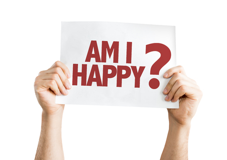 Hands holding cardboard on white background with text: Am I happy? Stock Photo