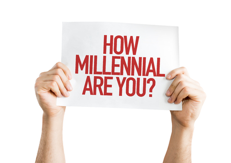 identidad cultural: Hands holding cardboard on white background with text: How millennial are you? Foto de archivo