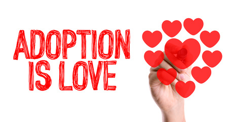foster parenting: Handwriting on white background with text: Adoption is love Stock Photo