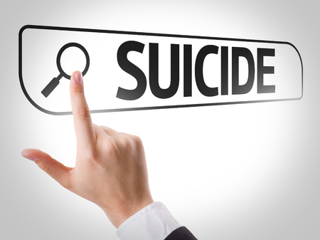 url virtual: Hand searching online on white background with text: Suicide Stock Photo