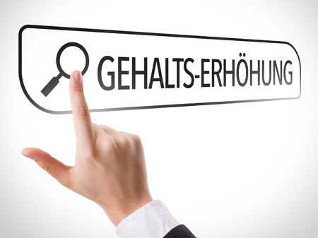 monthly salary: Hand searching online on white background with text: Gehalts-erhohung (salary increase in German)