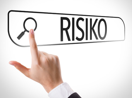 risiko: Hand searching online on white background with text: Risiko (risk in German) Stock Photo