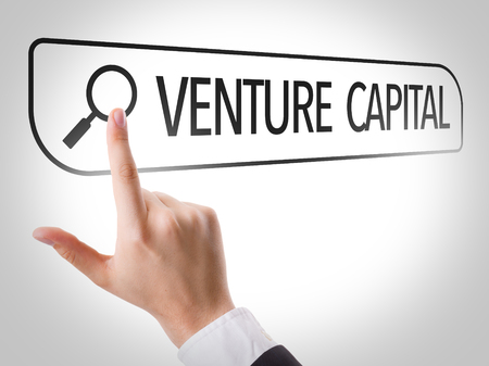 venture: Hand searching online on white background with text: Venture capital Stock Photo