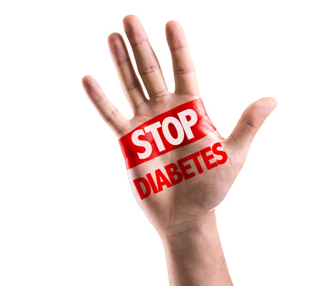hyperglycemia: Hand on white background with text: Stop diabetes Stock Photo