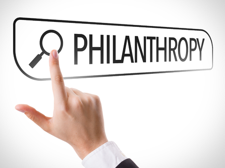 philanthropy: Hand searching online on white background with text: Philanthropy