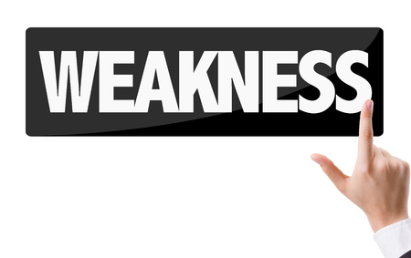 frailty: Finger pointing at the word: Weakness Stock Photo