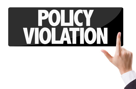 violation: Finger pointing at the word: Policy Violation Stock Photo