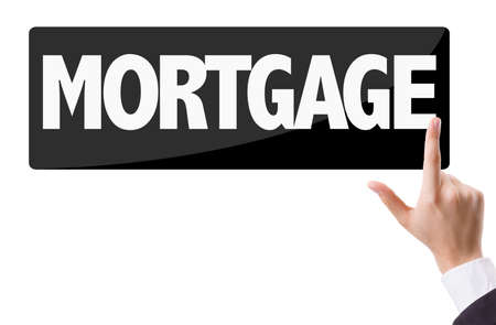 loaning: Finger pointing at the word: Mortgage