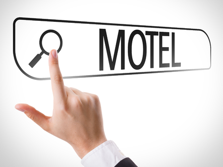 holiday budget: Finger pointing at search bar with Motel