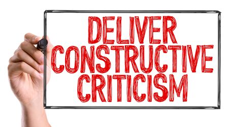 deliver: Deliver constructive criticism written with a marker pen