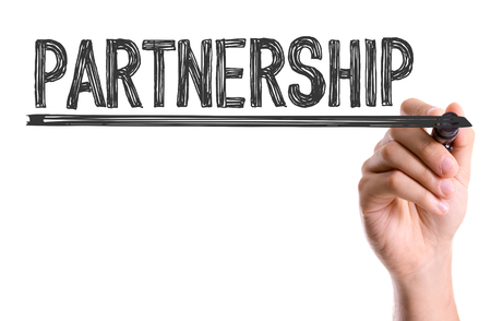 synergism: Partnership written with a marker pen