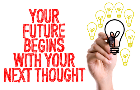 Your future begins with your next thought written with a marker pen Stock Photo