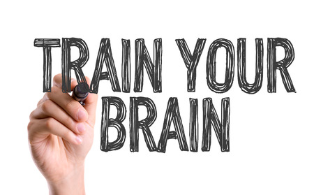 cognition: Train your brain written with a marker pen Stock Photo