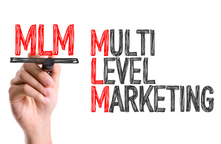 multilevel: MLM (Multi-level Marketing) written with a marker pen Stock Photo